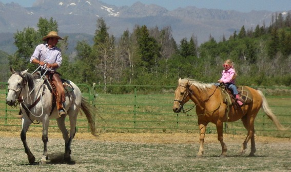 Family horse riding at The Home Ranch in Clark, Colorado